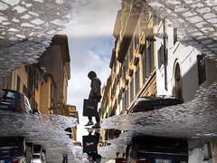 Crossing Puddles (Feldore) Tags: rome puddle rain street candid cobbled cobblestones woman crossing reflection reflected italy italian feldore mchugh em1 olympus 1240mm yellow
