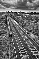 Never leave the tracks ...  (Fossano railway bridge, Piedmont, Italy). (Federico Fulcheri Photo) Tags: federicofulcheriphoto©️ italy piedmont fossano way horizon transportation nature sky clouds storm blackandwhite train rail railway nopeople outdoors snapseed canonitalia canon