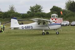 G-ARFO (IndiaEcho) Tags: light england canon airport general aircraft aviation hampshire aeroplane civil popham basingstoke airfield eghp eos fly microlight in 1000d 150 cessna garfo