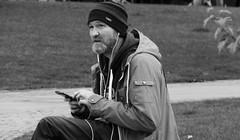 Lost In Music 02 (byronv2) Tags: peoplewatching candid street music earphones phone cellphone mobilephone sitting seated bench bamc park blackandwhite blackwhite bw monochrome saintandrewssquare newtown edinburgh edimbourg scotland man beard hat cap
