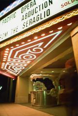 Ricoh R1 El Portal Theater (▓▓▒▒░░) Tags: ricoh compact point shoot color japan la los angeles california history bike ride architecture landmark arts analog mechanical classic retro vintage antique 35mm film camera design style artdeco theater neon