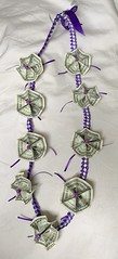 Money Lei (Pictures by Ann) Tags: moneylei purple silver ribbon braided origami money nine symbolic luckynine chinesenumerology symbolism ponybeads bow practical schoolcolors useful special highschoolgraduation gift present graduationgift