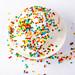Vanilla ice cream with multi-colored powder. Top view