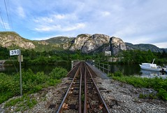 Mamquam Train Bridge - Squamish, BC (SonjaPetersonPh♡tography) Tags: squamish seatoskyhighway britishcolumbia canada nikon nikond5300 afsdxnikkor18300mmf3563gedvr landscape mountains mountainlandscape thestawanuschief mongolith rock railway bcr bcrailway mamquamtrainbridge bridge trainbridge mamquamblindchannel channel water viewpoint scenic scenery beautifulbc thestawanuschiefmountain bcrail