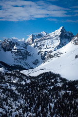 Rocky Peaks (ellieupson) Tags: alberta rockies rockymountains canmore canada banff nationalpark mountain snow sky trees aerial landscape