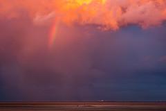 Big sky little humans (Gullivers adventures) Tags: sky big irelad clouds mammatus beach rainbow seascape sandy blue flickr colours sunset sunburst