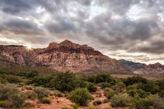 sunsetting at Red Rock Canyon (kderricotte) Tags: redrockcanyon nevada sony sonya7iii ilce7m3 sunset sunburst clouds sky sel1635z rocks mountain sonyvariotessartfe1635mmf4zaoss sunstar