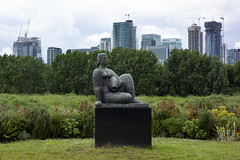 """Woman and Fish,"" Millwall Park (London Less Travelled) Tags: uk unitedkingdom britain england london isleofdogs dockland towerhamlets canarywharf redevelopment development eastlondon eastend urban city dobson sculpture park millwall millwallpark skyline islandgardens"