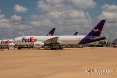 N879FD FedEx | Boeing 777-FS2 | Memphis International Airport (M.J. Scanlon) Tags: 777 777fs2 absolutelypositivelyovernight air aircraft aircraftspotter aircraftspotting airliner airplane airport aviation boeing canon capture cargo digital eos fedex federalexpress flight fly flying freight freighter haul image impression jet jetliner logistics mem memphisinternationalairport mojo n879fd packages perspective photo photograph photographer photography picture plane planespotter planespotting scanlon spotter spotting super theworldontime view wow ©mjscanlon ©mjscanlonphotography