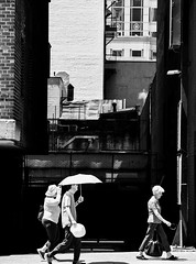 Hot Time in the City (Kenneth Laurence Neal) Tags: newyorkcity urban cities cityscape blackandwhite blackdiamond monochrome monotone street streetphotography umbrella nikon nikond7100 buildings people