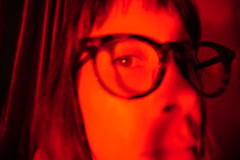 149/365: red room (no filter) (Fille.de.Lumière) Tags: red redspace redroom colour monochrome warm warmcolours ofme selfportrait selfstudy selfie memyselfandi blur blurisbest redblur eye oneeyedjack glasses spectacles moody orangered leregard stare