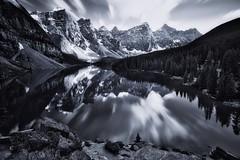 A deep and beautiful silence (Jim Nix / Nomadic Pursuits) Tags: longexposure travel canada mountains reflection monochrome sony banffnationalpark morainelake canadianrockies luminar jimnix sonya7ii