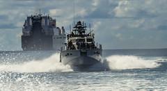 A Mark VI patrol boat transits away from USNS Dahl (T-AKR 312).