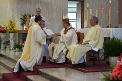 Deacon Holland receives Book of the Gospels