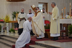 Bishop Persico imposes hands on Joe Petrone