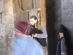Bagpiper in tunnel entrance to the Plaza  de  Obradoiro, Santiago  de Compostela,  Galicia, Spain (d.kevan) Tags: stone entrance tunnel santiagodecompostela galicia spain plazadeobradoiro musician streetperformer piper musicalinstrument niche movement light bagpipes