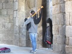 Bagpiper in tunnel entrance to the Plaza  de  Obradoiro, Santiago  de Compostela,  Galicia, Spain (d.kevan) Tags: stone entrance tunnel santiagodecompostela galicia spain plazadeobradoiro musician piper musicalinstrument niche musiccase light bagpipes streetperformers