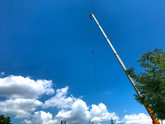 Construction site, crane against blue sky with clouds - stock photo (DigiPub) Tags: 1152527975 gettyimages