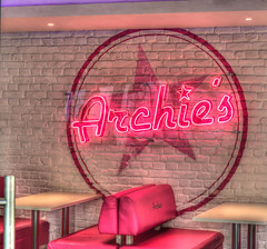 Archie's (stevefge) Tags: 2019 england liverpool merseyside uk neon cafe red star circles seat table brick reflectyourworld reflections nikon squares