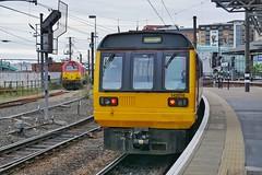 Out of the Way (JohnGreyTurner) Tags: br rail uk railway train transport tyneside diesel engine dmu multiple unit northern ews db dbs dbc 142 class142 67 class67 skip