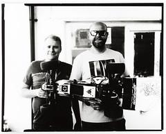 Boys & toys (Attila Pasek (Albums!)) Tags: 127mmf47 analogue positive kodakektar anniversaryspeedgraphic paper camera largeformat bw blackandwhite direct 4x5 harman graflex