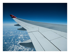 Westward bound (fishyfish_arcade) Tags: newyork lumix flying flight panasonic boeing747 jumbojet virginatlantic gx7 gvariof35561260mm wing bluesky airborne