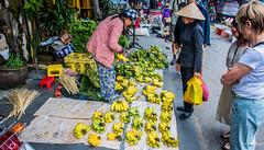 2019 - Vietnam - Hoi An - 17 of 47 (Ted's photos - Returns late June) Tags: 2019 cropped hoian nikon nikond750 nikonfx tedmcgrath tedsphotos vietnam vignetting bananas fruit peopleandpaths pathsandpeople people streetscene street hats hoianvietnam market streetmarket