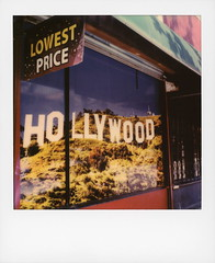 A Hollywood Sign 169 (tobysx70) Tags: polaroid originals color 600 instant film slr680 a hollywood sign 169 souvenir outlet blvd boulevard cherokee avenue los angeles la california ca window display lowest price tourist shop store awning blue sky mount lee toby hancock photography