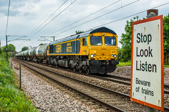 66722 Great Moulton 30/05/19 - Stop, Look, Listen to the sound of the tanks. 66722 speeds past Green Lane foot crossing, Great Moulton on an overcast afternoon. (rhayward92) Tags: 66722 gbrf gb railfreight class 66 great moulton geml eastern mainline 6a32
