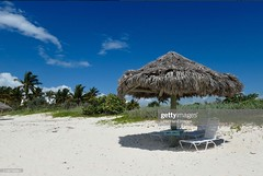 All in a Day's Work (Little Hand Images) Tags: beach whitesand palmumbrella chairs shade palmtrees tropical traveldestination cruise freeport grandbahamas privatebeach gettyimages