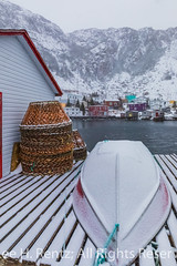 Crab Pots and Boat on Francois Outport Dock in Newfoundland (Lee Rentz) Tags: atlantic atlanticcanada atlanticocean february francois francoisbay newfoundland newfoundlandandlabrador southcoast adventure beautiful boat buildings canada coast coastal coastline colorful colors colours crabpots dock ferry fishing fishingvillage fjord harbor harbour homes houses isolated landscape lights mountainous mountains northamerica outport remote snow snowing snowstorm snowy stage town travel vertical village waterfront weather winter