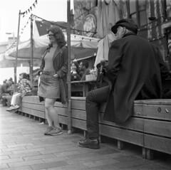 Observe (4foot2) Tags: streetphoto streetshot street streetphotography candid candidportrate reportagephotography reportage people peoplewatching peopleofbrighton interestingpeople newroad northlaines laines analogue film filmphotography 120film mediumformat bw blackandwhite monochrome mono hasselbladski kiev kiev88cm 88cm киев88cm ukrainiancamera carlzeissjenabiometar80mm28 carl carlzeissjena zeiss jena biometar80mm28 biometar 80mm f28 28 ilford ilfordhp5plus hp5plus standdevelop rodinal 2019 fourfoottwo 4foot2 4foot2flickr 4foot2photostream
