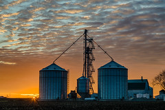 Silo Sunset (tquist24) Tags: goshen hdr indiana nikon nikond5300 outdoor barn clouds cloudy evening farm grainsilo longexposure orange outside rural silo sky sunburst sunset