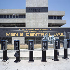 payphones. los angeles, ca. 2009. (eyetwist) Tags: eyetwistkevinballuff eyetwist losangeles county jail sheriff payphones dtla 6x6 film mamiya 6mf 50mm kodak portra 160vc mamiya6mf mamiya50mmf4l kodakportra160vc ishootfilm ishootkodak analog analogue emulsion mamiya6 square mediumformat 120 primes filmexif aicolor epsonv750pro lenstagger angeleno los angeles la socal california sidewalk downtown building streetscape urban phonebooth telephone payphone row custody release arrest bail inmate bauchetstreet concrete cell central menscentraljail street arraignment courts
