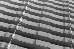 Hypnotic Condo II (Dekhana Photo) Tags: naniwa ward osaka kansai minolta ilford delta400 x700 analog film architecture building pattern dekhanaphoto andregenel japan japon condos hypnotic concrete pellicule blackwhite noiretblanc monochrome