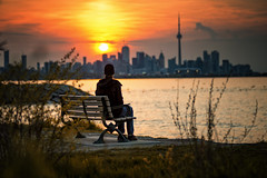 Wake up and enjoy the view (Paul Flynn (Toronto)) Tags: toronto humber bay park bench sunrise morning orange sun water harbour harbor downtown city cityscape scenic dawn