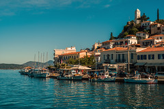 Waterside..... (Dafydd Penguin) Tags: waterfront waterside quayside harbour harbor port dock fishing vessel quay water sea town tower poros island saronic gulf greece leica m10 summicron 50mm f2