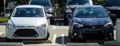 Parking Lot Theatrics (49er Badger) Tags: toyota yaris corolla melpomene thalia masks tragedy comedy