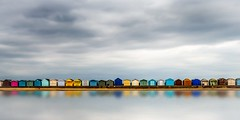 A row of beach huts (ainz1607) Tags: colour beach seaside beachhut uk summer sea sky row reflections