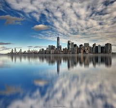 Ciudad en el horizonte - City on the horizon  01 (ricardocarmonafdez) Tags: newyork nyc manhattan skyline skyscraper sky rascacielos cielo cityscape nubes clouds blue reflections reflejos simetría symmetry arquitectura architecture imagination effect mirror composition nikon d850