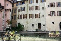 Along the riverside...hff xx (shona.2) Tags: flowers shutters windows architecture history old bicycle bike buildings frenchalps annecy annecyoldtown france fencefriday hff