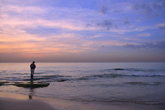 Alone (Roi.C) Tags: sun sunset clouds sky water wave waves seascape landscape sea outdoor nikon d5300 nikkor israel sunlight serene beach cloud 2017 season ligh photograph digital outside ocean sunrise fotografer photo night view shot framing frame interesting colors colours color 18140mm romantic evening lighting photography composition lens blue mediterraneansea ngc reflection silhouette fishing
