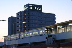 The hotel and the station (しまむー) Tags: fujifilm xe2 ebc fujinon 55mm f18 velvia yokohama kabushima 横浜 蕪島 八戸 蕪島神社 菜の花