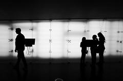 One goes (stefankamert) Tags: onegoes silhouette light shadows noir blackandwhite blackwhite signs people stefankamert lines noiretblanc bw ricoh gr grii friedrichshafen zeppelinmuseum