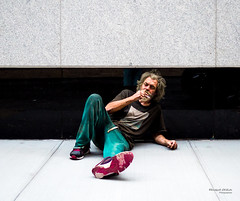 The New Yorkers - Down and out (François Escriva) Tags: street streetphotography us usa nyc ny new york people candid olympus omd photo rue light man colors sidewalk manhattan homeless smoke black green red cigarette wall