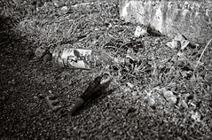 Leftovers from poisoned life (Geir Bakken) Tags: analog analogue analogphotography film filmisnotdead filmphotography 35mmfilm 135 rolleirpx rolleirpx25 blackandwhite bw bottle urban gritty