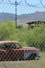 old car near roundhouse (EllenJo) Tags: vintage car clarkdale az barbedwire may31 2019 ellenjo canonrebel telephoto fence chainlink jerome sunbaked faded pentaxks1 pentax
