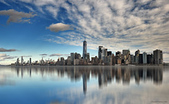 City on the horizon - 02 (ricardocarmonafdez) Tags: newyork nyc manhattan skyline skyscraper sky rascacielos cielo cityscape nubes clouds blue reflections reflejos nikon d850 mirror imagination effect edition processing