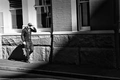 Doff your hat (cupitt1) Tags: monochrome mono blackandwhite black dark shadow shadows light shaft man cap tip doffing sydney street str
