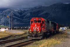 Departing a stormy Jasper (Moffat Road) Tags: canadiannational cn jasperyard jasper alberta canada storm darkclouds mountains jaspernationalpark cnalbredasub train emd sd402 locomotive railroad 5367